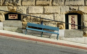blue bench by pub on steep road