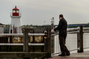 man looks at lighthouse