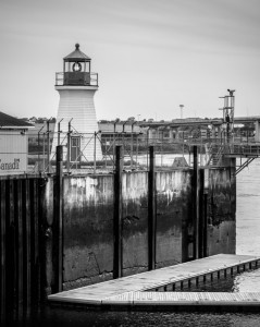 black and white lighthouse and seawall