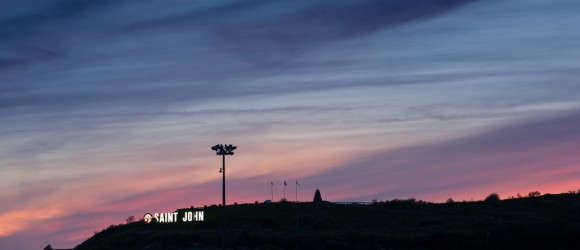 saint john sign on hill at dusk