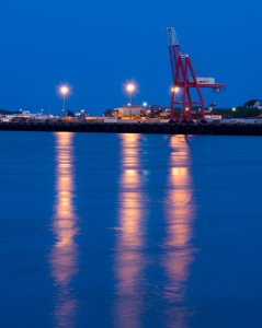 shipping dock and crane at blue hour