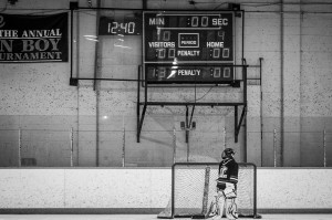 Goalie looking at scoreboard