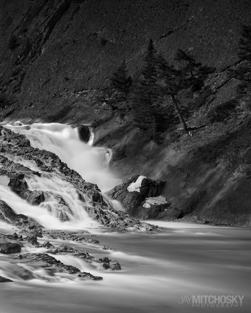 Water cascades down the Bow Falls in Banff, Alberta.  {Photo: Jay Mitchosky}