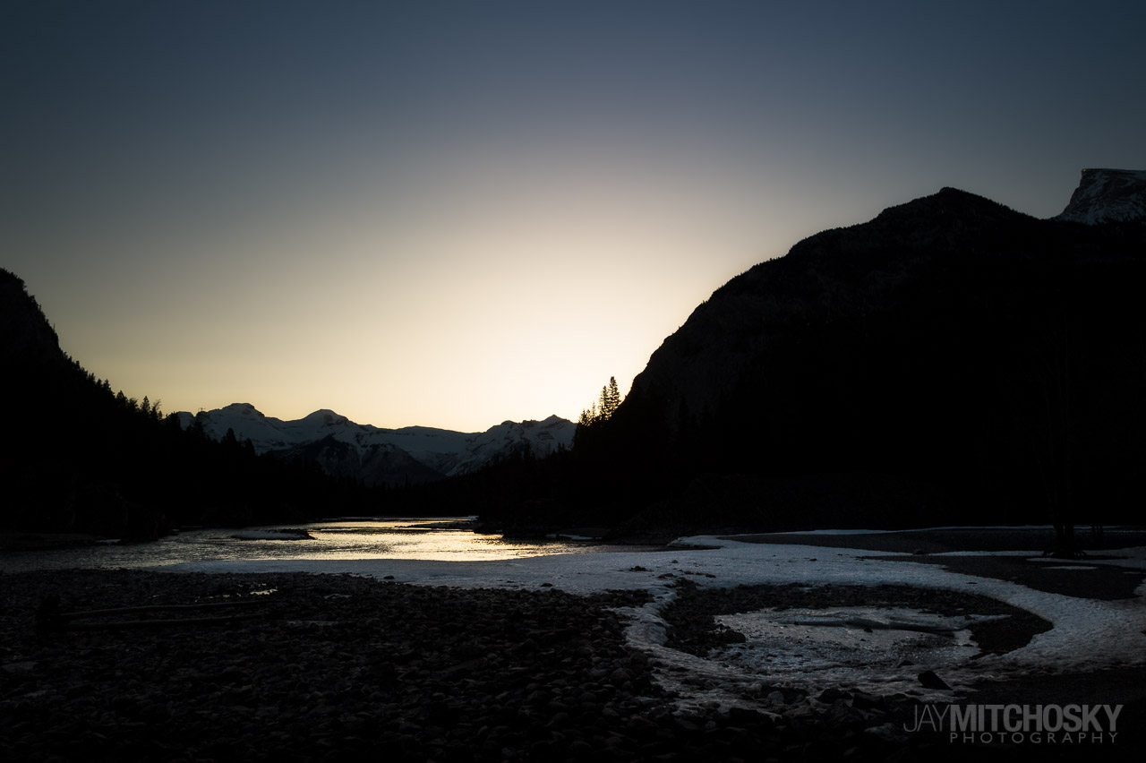 Dawn light over the Bow River in Banff, Alberta.  {Photo: Jay Mitchosky}