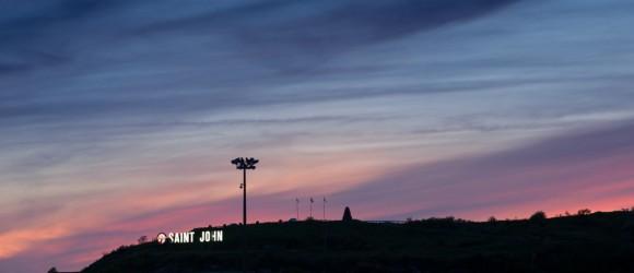 saint john sign on hill at dusk